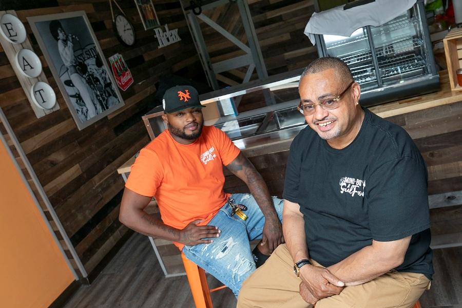 Above, Deja Durant, left, and John Small, co-owners of Mind, Body & Soul Food, pose for a photo on Friday at the new restaurant at 511 W. Main St., Meriden. The new restaurant will serve mac-n-cheese, collard greens and chicken and waffles along with cheesesteak sandwiches, chili dogs and tuna wraps.