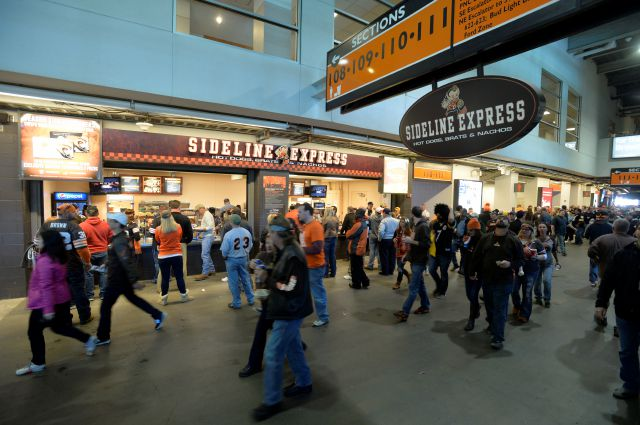 In this Oct. 12, 2014, photo, fans walk past food concession stands before a game between the Browns and Steelers in Cleveland. Associated Press
