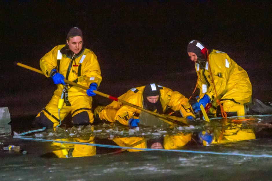 Firefighters from Kensington and Berlin removing an ice section for their Cold Water Training on Monday night Feb. 4, 2019. | Ron Paris, Special to the Record-Journal
