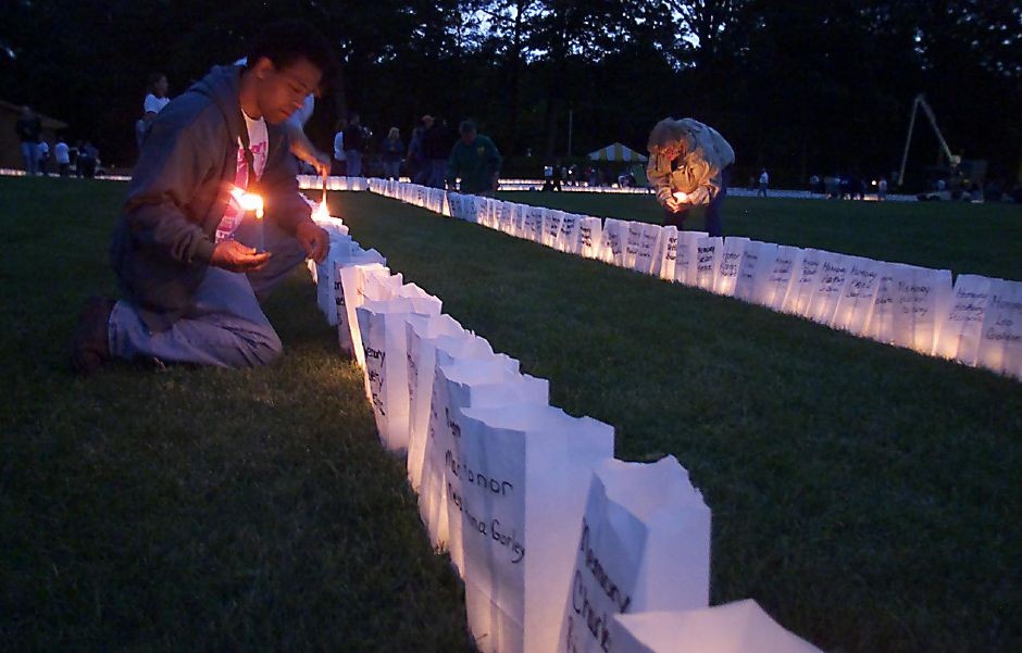 Over 4,800 luminaries are lit Sunday night at Hubbard Park for the Relay for Life event to raise awareness to help fight cancer June 4, 2000. Jesse Timm of Meriden aided volunteers by helping to light the luminaries at the beginning of the evening.