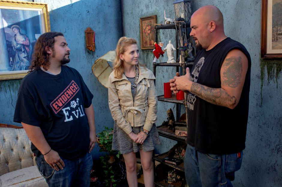 Record-Journal Digital Content Producer Ashley Kus, center, talks with Dave Delas, left, and Bobby Besaw, right, about creating the Evidence of Evil haunted attraction behind Crystal Bees in Southington Sept. 20, 2018. Evidence of Evil opens Sept. 28. | Richie Rathsack, Record-Journal