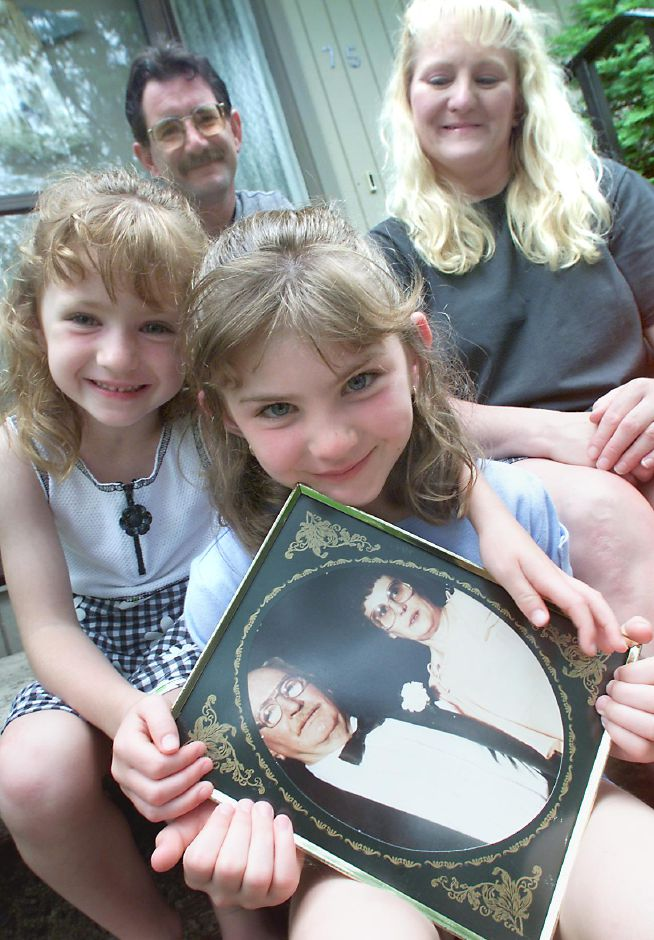 "FATHER""S DAY LETTERS: Amanda Coitrone,7 of Meriden holds a photo of her grandfather, the late Edward McGourn with Amanda"