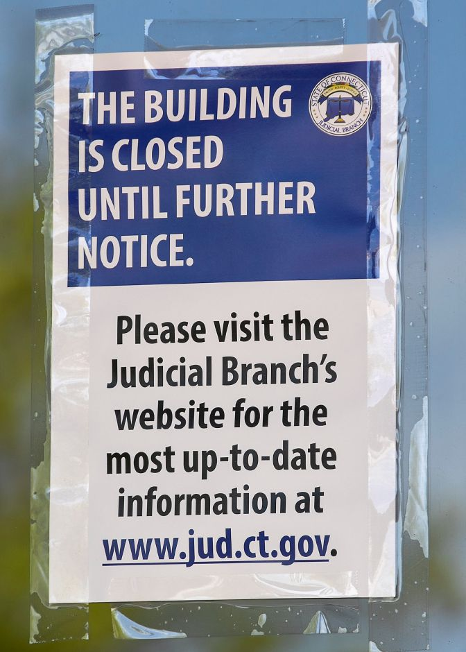 "One of several ""building closed"" signs displayed on the front doors of the State of Connecticut Superior Court, 54 W. Main St., Meriden, Fri., May 22, 2020. Dave Zajac, Record-Journal"