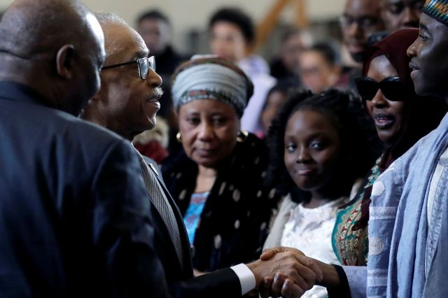 The Rev. Al Sharpton, second from left, civil rights activist and founder of the National Action Network, shakes hands with Imam Al Hassan Kamagtey, of Yonkers, N.Y., right, as Omo Muhammed, second from right, mother of 19-year-old fatal shooting victim Mubarak Soulemane, looks on, Sunday, Jan. 26, 2020, during ceremonies to honor Soulemane