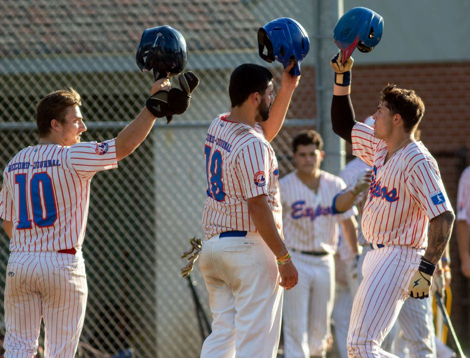 From left, Record-Journal Expo's Jack Rich and Jason Sullivan greet Mike Gulino after he hit a 3 run home-run against Ulbrich Steel in the bottom of the second inning. Aaron Flaum, Record-Journal