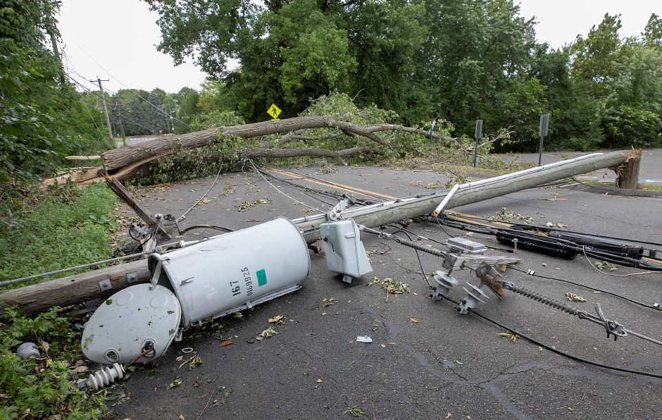 A fallen tree and downed utility pole block a portion of Atwater Street in Southington, Thurs., Aug. 6, 2020. Dave Zajac, Record-Journal