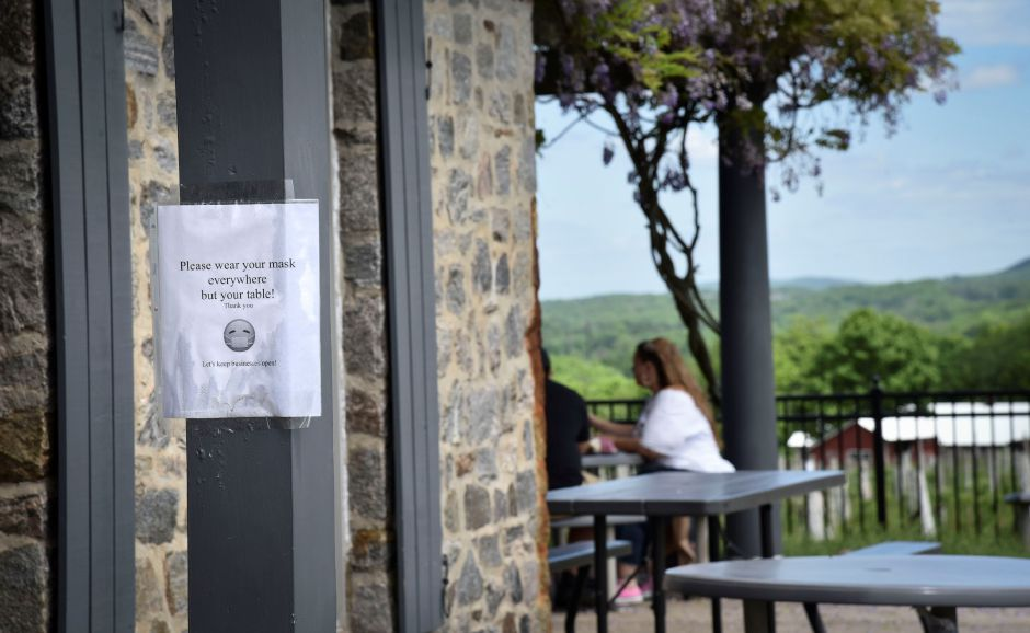 Signs at Gouveia Vineyards on Saturday, May 30, 2020, reminds guests of official state rules. Restaurants, breweries and wineries are allowed to have outdoor dining at this time in the state