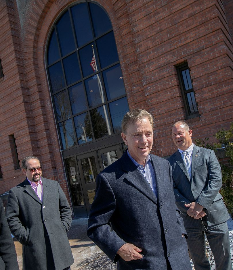 Town Councilors Vincent Cervoni, left, and Craig Fishbein, right, wrap up a tour of the uptown area of Wallingford with Gov. Ned Lamont, Thurs., Feb. 28 2019. Dave Zajac, Record-Journal