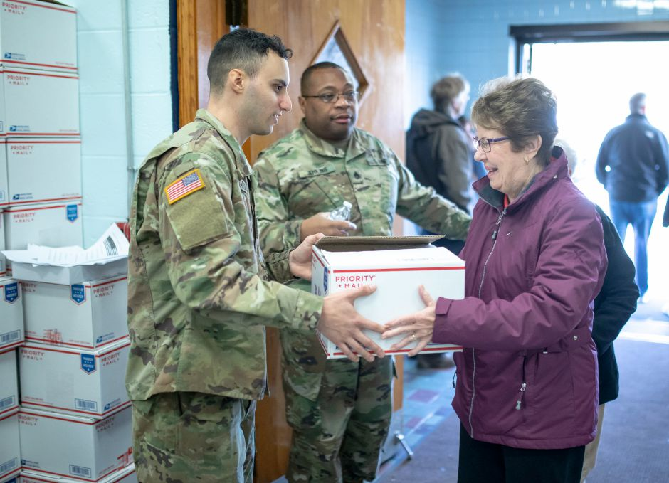 Virginia Bruen, of Berlin, takes a care package box from a soldier at the New Britain Veterans of Foreign Wars post for the Hero Boxes care package packing day on Nov. 9, 2019. The Berlin-based non-profit sends hundreds of care packages to soldiers serving in war zones each year. | Devin Leith-Yessian/Berlin Citizen