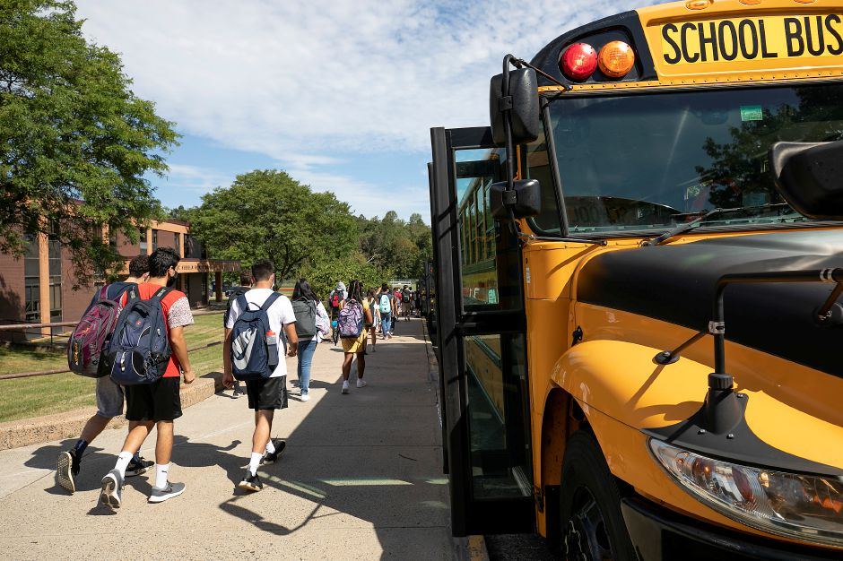 Sheehan High School students head to their buses at dismissal on the first day of school in Wallingford, Thurs., Sept. 3, 2020. Dave Zajac, Record-Journal