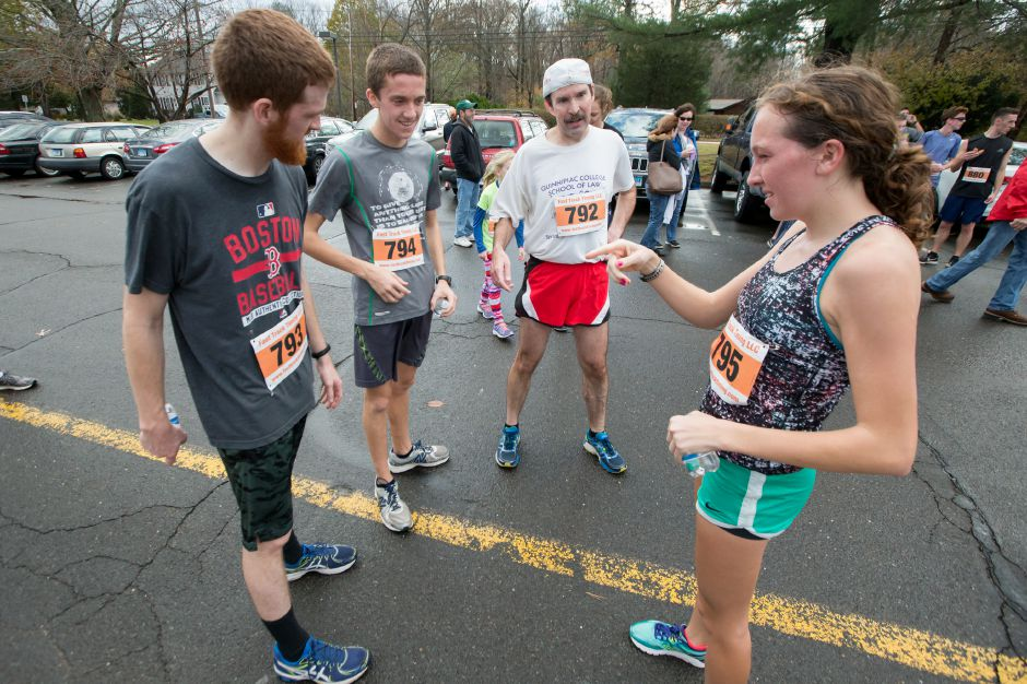 The Fenglers meet at the finish Tim left Stephen, Jeff and Liz Sunday during the Kiwanis Club 5 mile and 5K Turkey Trot Road Race at Stevens Elementary School in Wallingford November 19, 2017 | Justin Weekes / For the Record-Journal