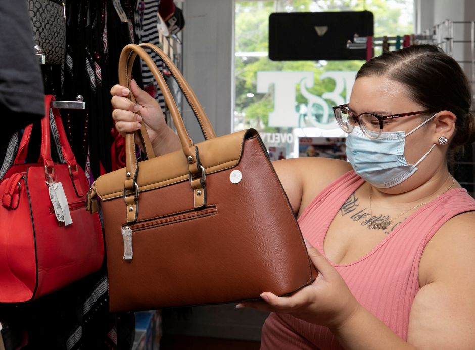 Gralynn Palmar, of Meriden, shops for a handbag at the new J&T Gifts and Novelty, 16A Center St., Wallingford, Tues., Jul. 7, 2020. Dave Zajac, Record-Journal