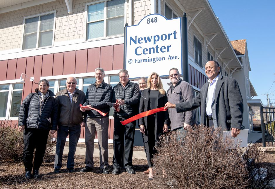 Southington-based developer Mark Lovley, center, cuts the ribbon for the renaming ceremony of Newport Center @ Farmington Ave., formerly Depot Crossing. The Berlin mixed-use building was purchased by Newport Realty, of which Lovley is a co-principal, in January 2020.