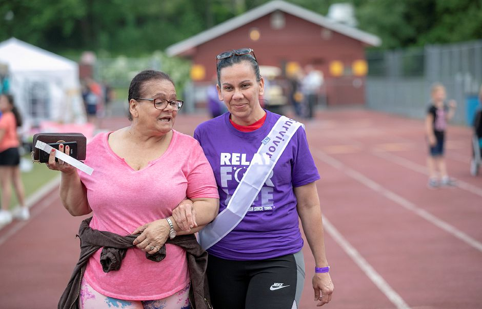 Primitiva Rivera, of Meriden, left, walks laps with friend Nereida Acevedo, of Meriden, right during the 24th annual Meriden/Wallingford Relay for Life at the Sheehan High School track, Fri., May 31, 2019. Acevedo is a 6-year cancer survivor. Dave Zajac, Record-Journal