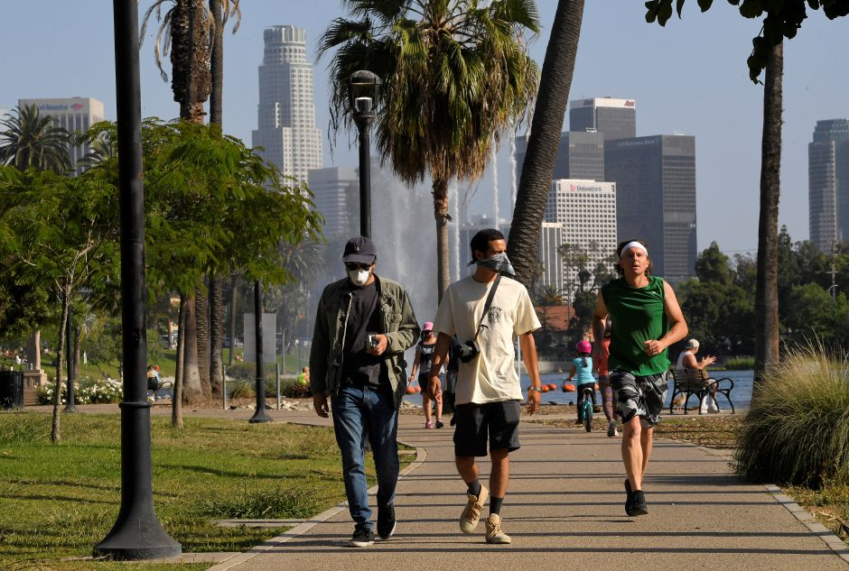 People utilize the Echo Park Lake recreation area Saturday, May 23, 2020, in Los Angeles during the coronavirus pandemic. California Gov. Gavin Newsom has approved 45 of California
