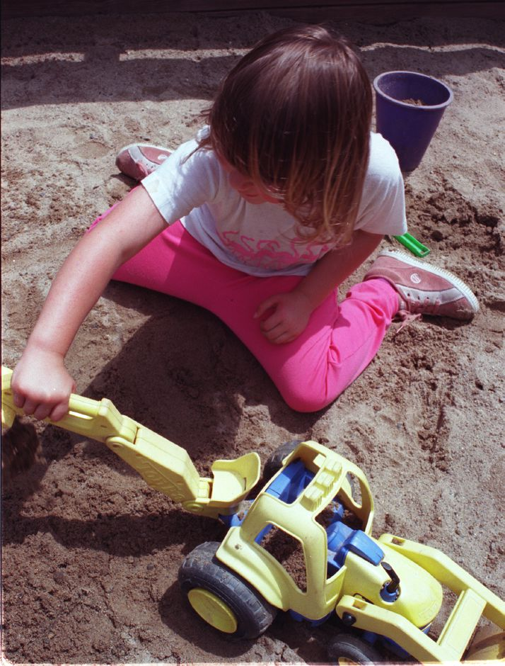 Madeleine Bennett, 4, of Wallingford, is digging a garden in the sandbox at the Richard C. Bartlem Recreation Center in Cheshire on Friday morning June 16, 2000.