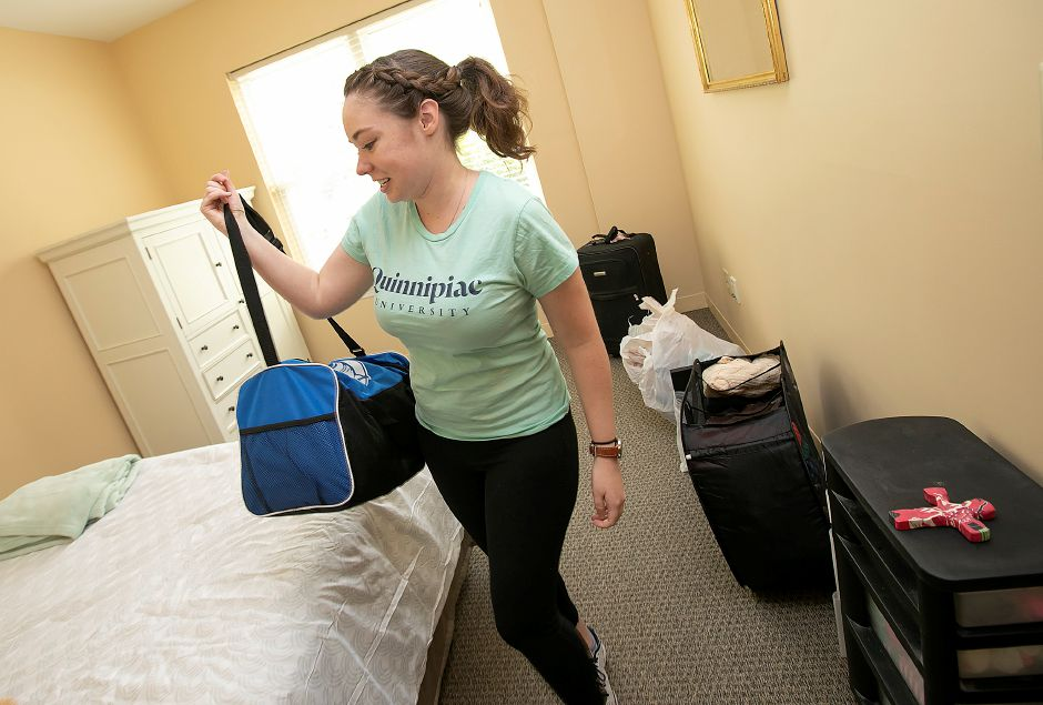 "Quinnipiac University law student Cathleen Dacey moves into her new residence at Pond Ridge assisted living on the Ashlar Village campus in Wallingford, Friday, August 17, 2018. Dacey will be living at Pond Ridge as part of the ""Students in Residence"" program. Dave Zajac, Record-Journal"