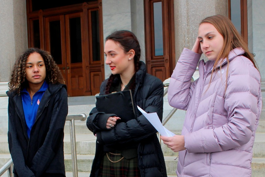 High school track athletes Alanna Smith, left, Selina Soule, center and and Chelsea Mitchell prepare to speak at a news conference outside the Connecticut State Capitol in Hartford, Conn. Wednesday, Feb. 12, 2020. The three girls have filed a federal lawsuit to block a state policy that allows transgender athletes to compete in girls sports. (AP Photo/Pat Eaton-Robb)