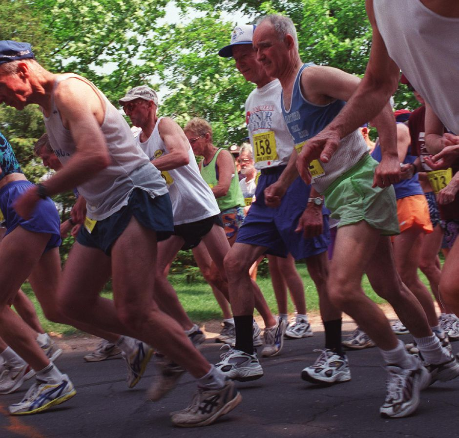 A crowd of runners lunge forward at the start of the Connecticut Senior Games 5-K road race on Marion Avenue in Southington Friday June 2, 2000.