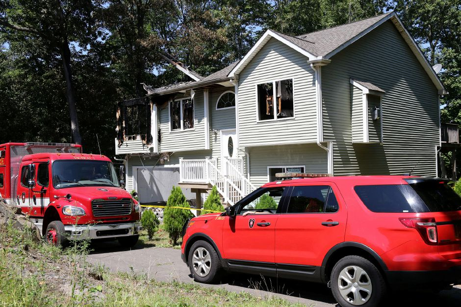 Meriden fire officials leave 67 Morley Drive in Meriden on Thursday August 15, 2019 after an early morning fire. Aaron Flaum, Record-Journal Staff