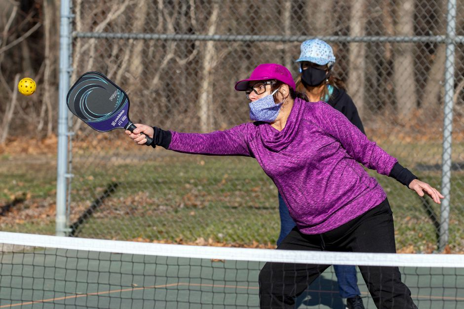 Debbie Saranitzky, of Meriden, reaches to make a return shot during a game of pickleball at Harrison Park in Wallingford on Friday, Jan. 8, 2021. Aaron Flaum, Record-Journal.com