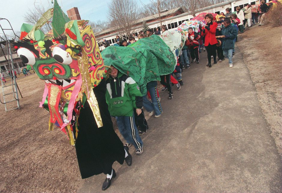 RJ file photo - At Parker Farms School in Wallingford, students parade a large Chinese dragon around the school grounds as part of a cultural study program, Feb. 1999.