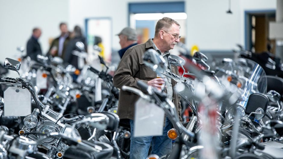 A man browses the motorcycle selection at Powerhouse Motorsports during the Plainville business