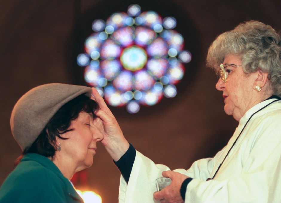 RJ file photo - Mildred Mariotti of Wallingford receives ashes from Minister of the Eucharist Pauline Palmero at Most Holy Trinity Church Feb. 17, 1999.