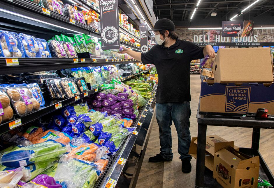 Chris Thompson restocks pre-package produce at Tops Marketplace in Southington on Tuesday, June 30, 2020. Aaron Flaum, Record-Journal