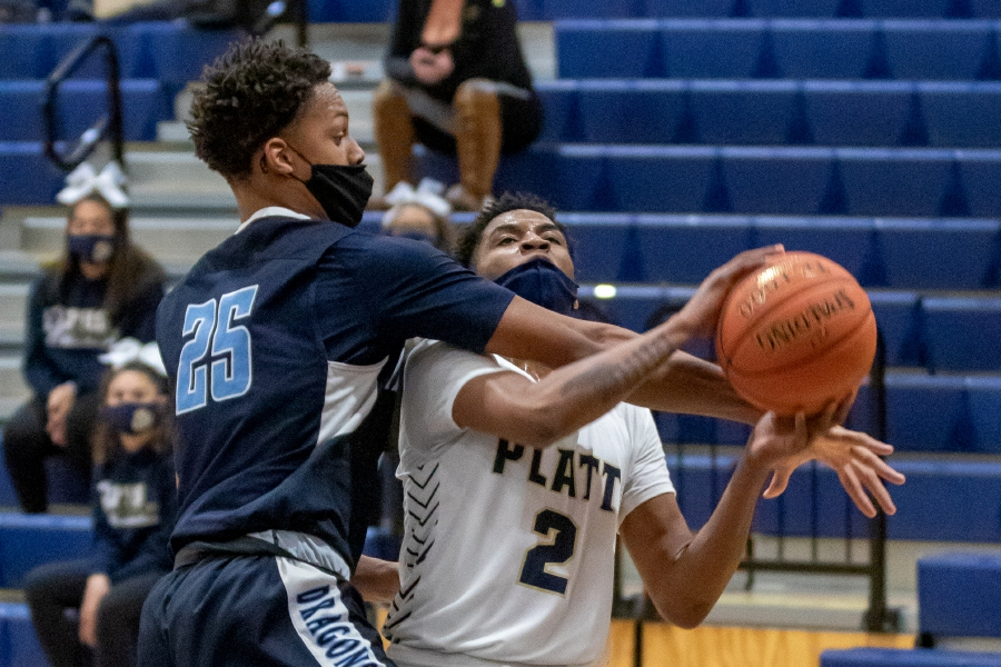 Platt's Henry Smith gets fouled by Middletown's Elijah Wilborn during the first half of Thursday's CCC Region D game at Platt High School, won by Middletown 83-51. Aaron Flaum, Record-Journal