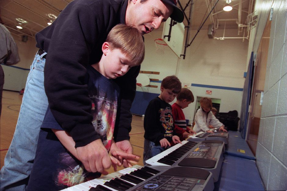 RJ file photo - Ryan White, 6, and other kindergarteners get music instruction from Dennis Bonito at the Wallingford Family YMCA March 1999.