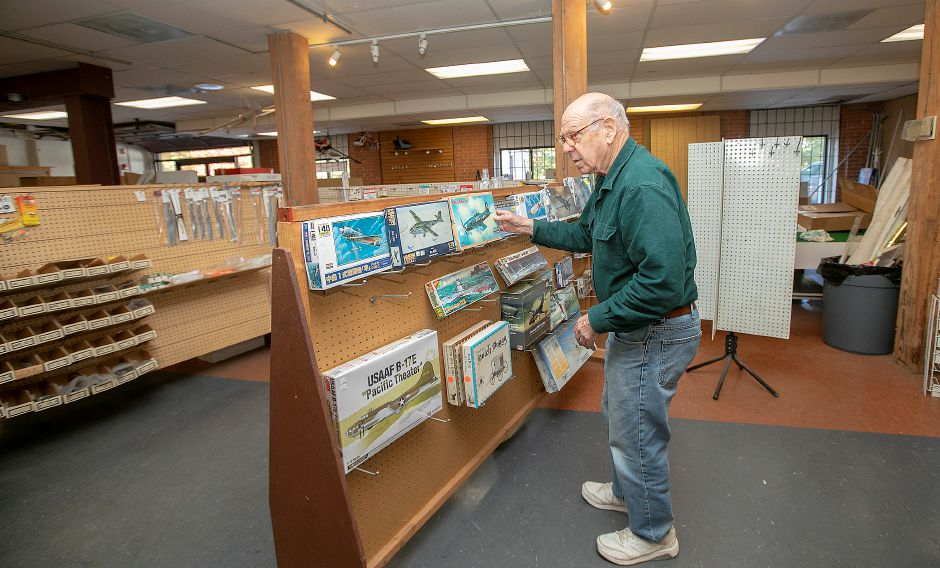 Myles Alderman, of North Haven, looks over airplane models at Build Right Fly Right Hobbies at 342 Quinnipiac St. in Wallingford on  Tuesday. Store owner Joe Acosta is retiring and closing the shop after 25 years. Photos by Dave Zajac, Record-Journal