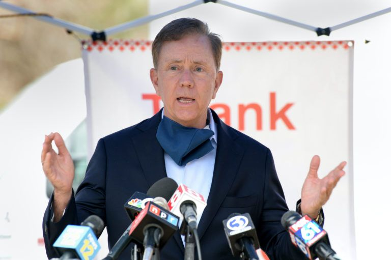 FILE: Connecticut Gov. Ned Lamont speaks during a press conference at a Red Cross blood drive at the Connecticut Police Academy in Meriden. Sen. Richard Blumenthal and Lt. Gov. Susan Bysiewicz were also in attendance. The purpose of their visit was to encourage residents who are healthy to donate blood.