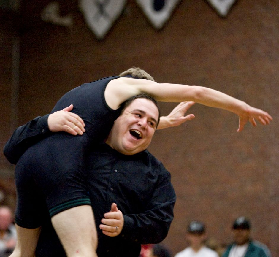 Maloney wrestling head coach Joe Ferreira reacts as Daniel Lupacchino jumps into his arms after pinning Platt