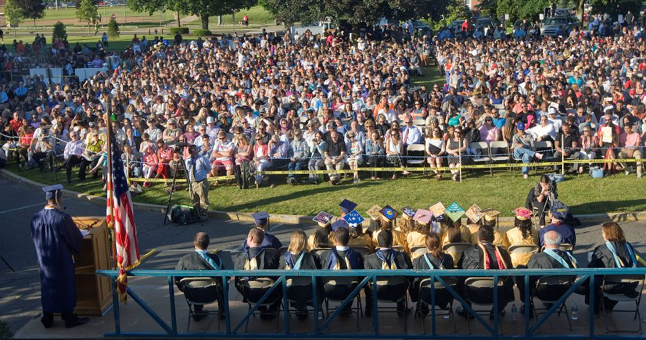 Edwin Roman, salutatorian, bottom left, speaks at the podium during graduation ceremonies at Platt High School in 2016. Details for this year's ceremony are being finalized this week. | File photo.