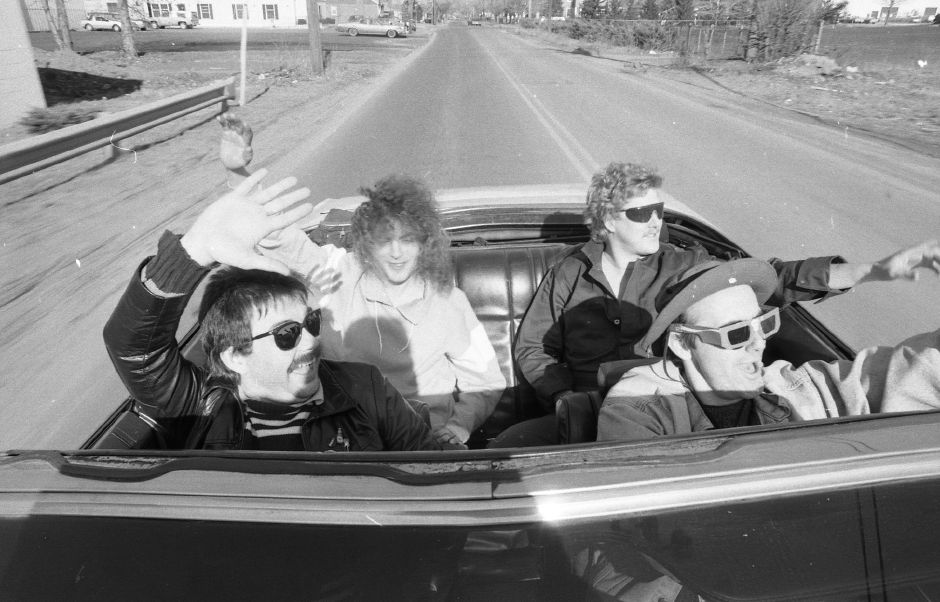 "RJ file photo - Although spring is still several weeks away, Paul Heriot, front right, decided to let the top down on his 1973 Buick Centurion and go on a cruise around Wallingford Feb. 1, 1989 with members of his band, The Presidential Targets. The foursome drove around town waving to pedestrians while doing what they call the ""pope wave"". Also pictured is Rod Maxwell, front left, Tom Dow and Walter Heinz, back row from left."