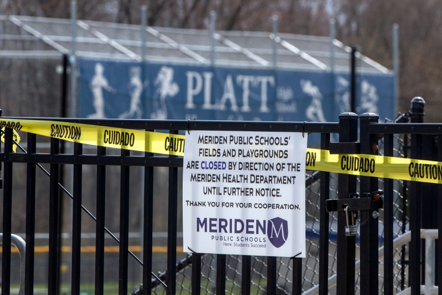 A sign affixed to the gate around Platt's new track and turf field lets the public know that all athletic fields and playgrounds at Meriden public schools are closed due to the COVID-19 outbreak. Aaron Flaum, Record-Journal