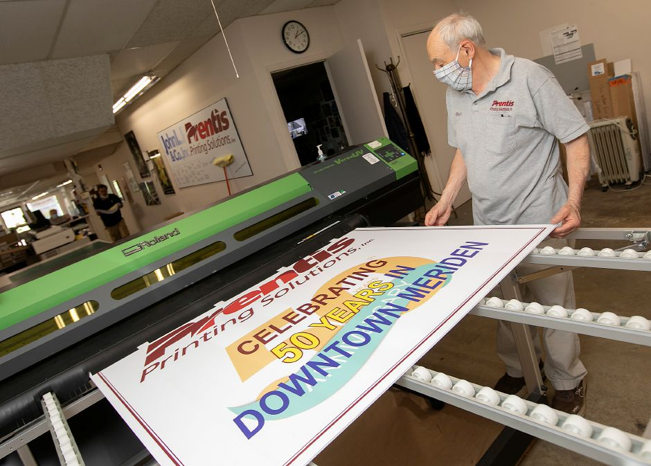 Bruce Burchsted, president, treasurer and bookkeeper of Prentis Printing Solutions, looks over a sign made for the 50th anniversary of the business in Meriden, Tues., Jun. 9, 2020. Dave Zajac, Record-Journal