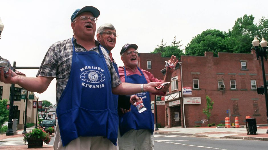 Meriden Kiwanis members,(L-R) Cliff Bradley, George H. Hamrah and Eddie Siebert, sell peanuts 3 bags for a dollar on West Main Street in Meriden on Thursday, the annual Kiwanis Peanut Day, June 12, 2000. The Kiwanis expect to raise over $10,000. There were volunteers all over Meriden selling and delivering peanuts for the day long fundraiser.