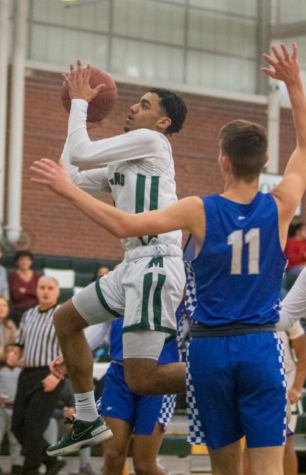 Maloney junior point guard Vincent Martinez scored 32 points Friday night to guide the Spartans to a 69-62 victory over Berlin in Meriden. | Aaron Flaum, Record-Journal