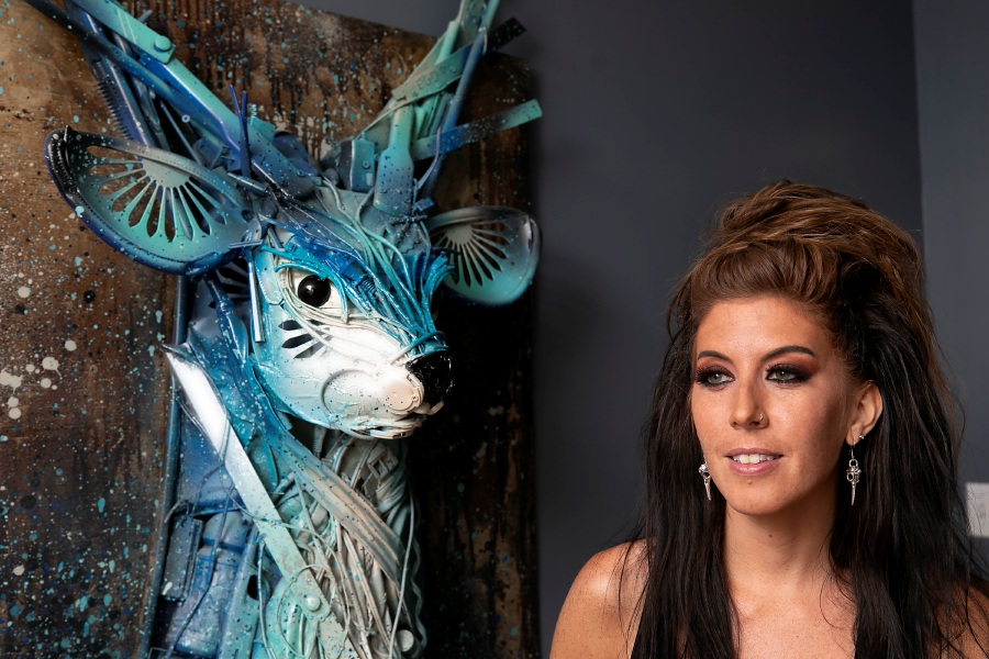 "Artist Stephanie Hongo, of Southington, talks about her first trash sculpture of a stag titled ""Yondu,"" Fri., Jun. 26, 2020. Hongo created the piece in 2017 using plastic paper plate holders, old handbags and various plastics from around her home. Dave Zajac, Record-Journal"