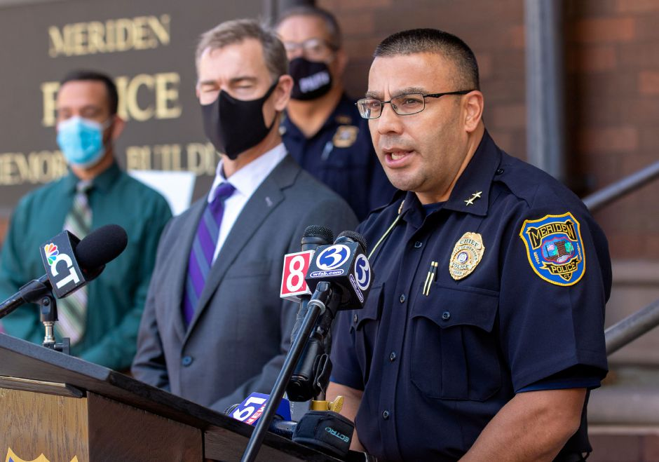 FBI Special Agent David Sundberg looks on as Meriden Police Chief Roberto Rosado as he addresses the media about a joint task force during a press conference in front of the Meriden Police Department on Wednesday, Oct. 21, 2020.