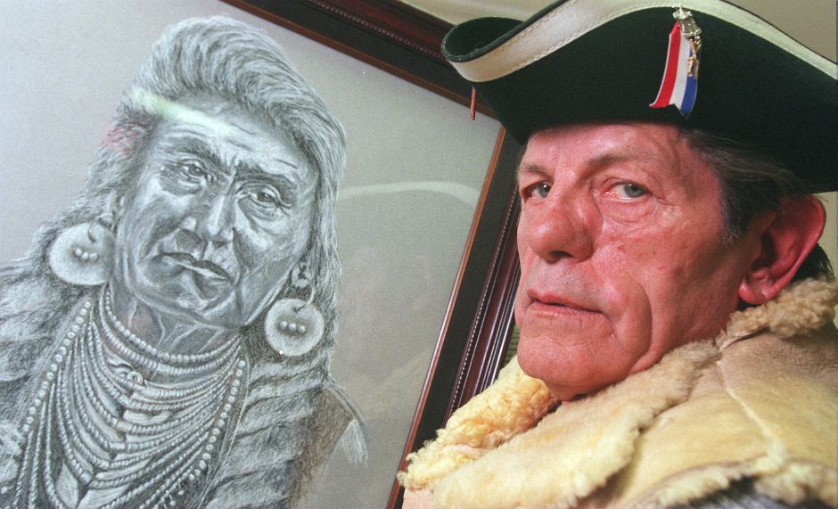 RJ file photo - Tom Thompson stands next to his painting of an American Indian Chief. His artwork is on display at the Southington Arts and Crafts Association, Feb. 1999.