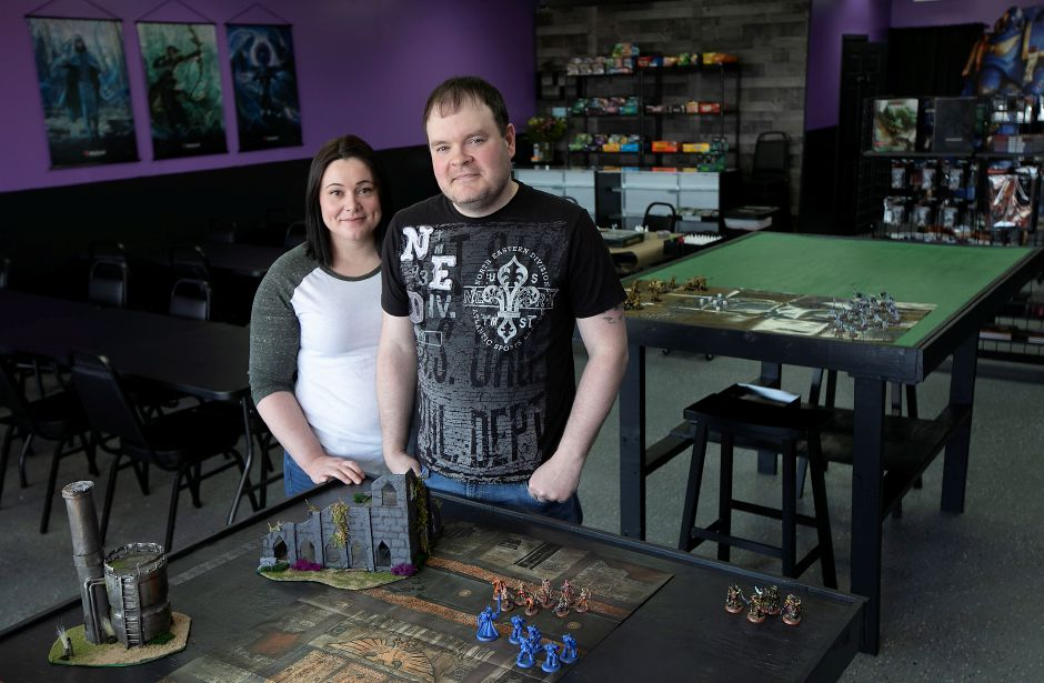Owners Eric and Christina DeVeau pose for a photo Wednesday inside The Raven's Nest, located  in the plaza at 2211 Meriden-Waterbury Turnpike in Southington. The new shop opens March 1 and is looking to be the area home for tabletop games such as Warhammer 40,000, Pokémon, X-Wing and Dungeons & Dragons. Photos by Dave Zajac, Record-Journal