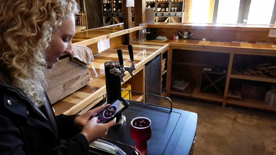 Record-Journal reporter Bailey Wright photographs the Yankee Cider Co.