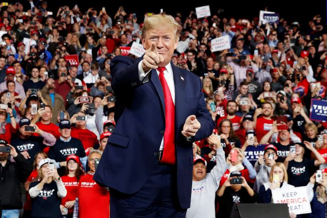 FILE - In this Jan. 9, 2020, file photo, President Donald Trump points as he arrives to speak at a campaign rally, in Toledo, Ohio. As the Democratic primary intensifies ahead of the first voting contests, President Donald Trump and his allies have issued a series of favorable comments about Democrat Bernie Sanders. It
