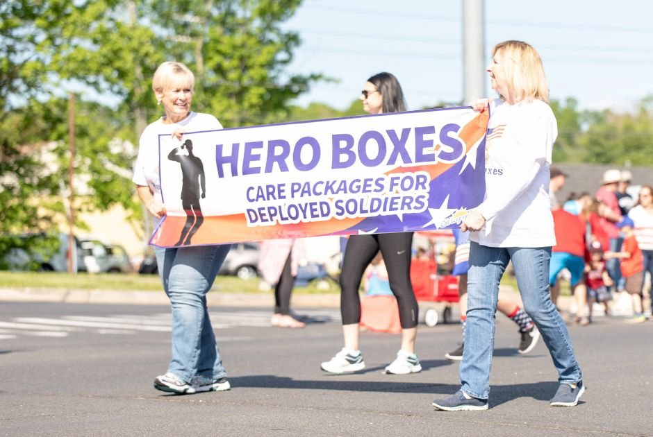 Members of the local nonprofit Hero Boxes march in the Berlin Memorial Day parade on May 25, 2019. Dozens of local service groups and businesses marched down Farmington Avenue to the Veterans Memorial Park, where a service was held in memory of fallen veterans. | Devin Leith-Yessian/Berlin Citizen