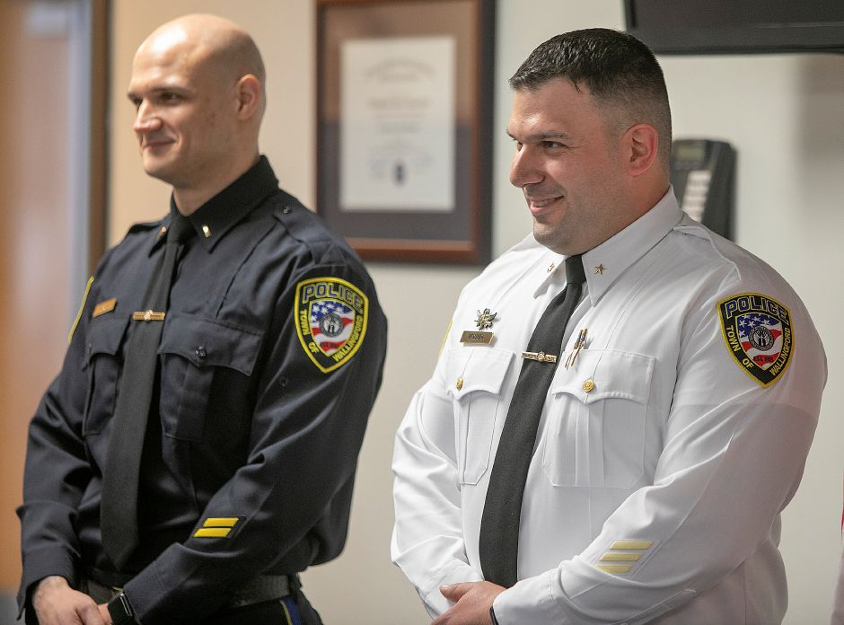 Sgt. James Cifarelli, left, and Lt. John Ventura stand during a badge-pinning ceremony at the Wallingford Police Dept., Mon., Apr. 29, 2019. Ventura was promoted to deputy chief and Cifarelli was promoted to lieutenant. Dave Zajac, Record-Journa
