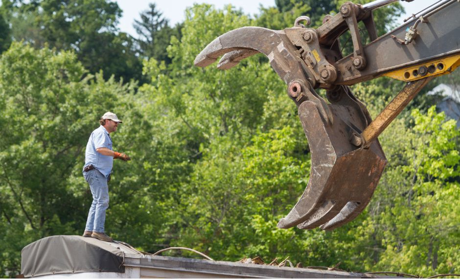 FILE PHOTO: A contractor directs an excavator as demolition continues at the former Ideal Forging site in Southington, July 23, 2015. | Eric Vo / Record-Journal
