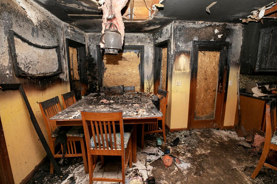 The dining area of a residence at 7 Huelstede Ln. in Wallingford heavily damaged by fire, Tues., Nov. 17, 2020. A family of six escaped the Monday morning fire but three cats were lost in the blaze. The family